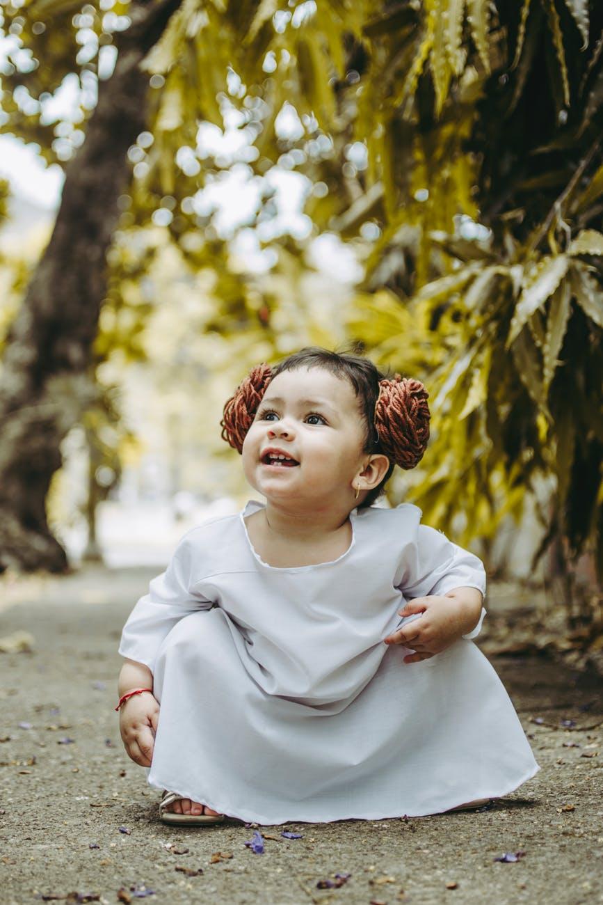 toddler girl sitting on floor